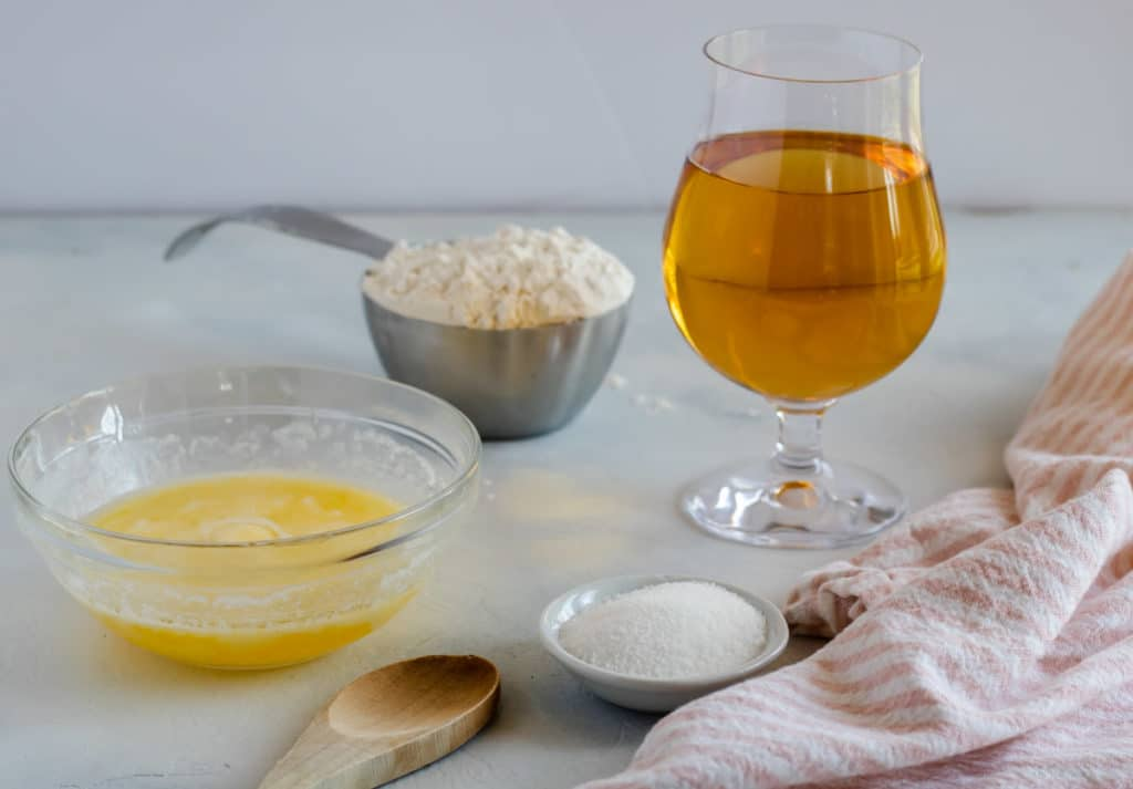 4 ingredients for beer bread- beer, self rising flour, sugar, and butter