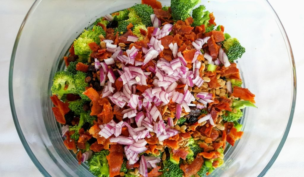 broccoli bacon salad ingredients in a glass bowl