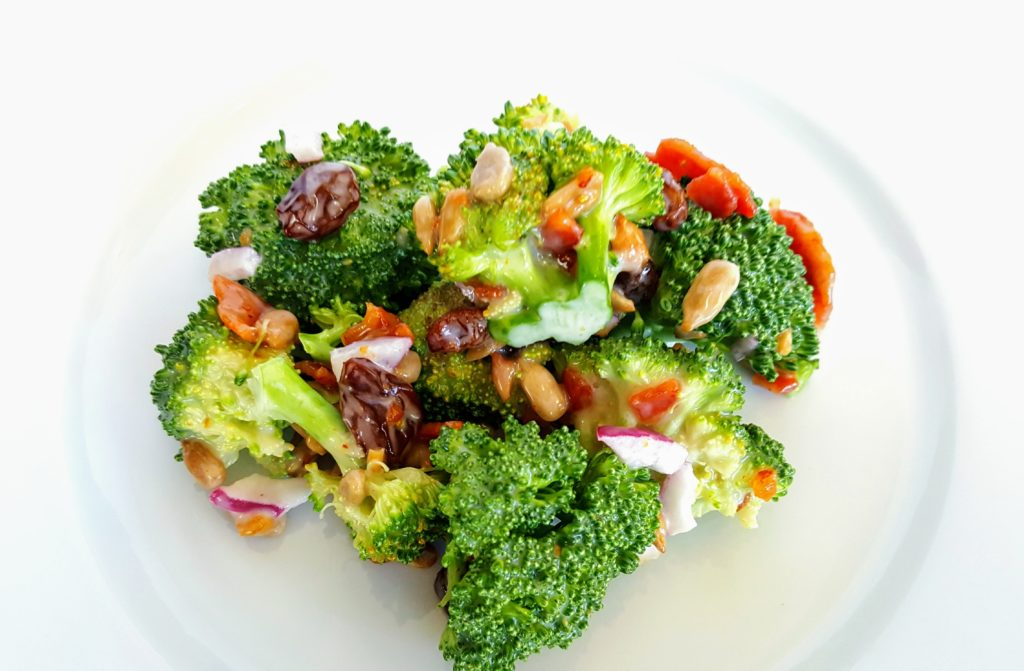 broccoli bacon salad on a white plate