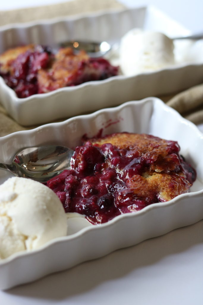 two square serving dishes with summer berry cobbler with ice cream momsdinner.net