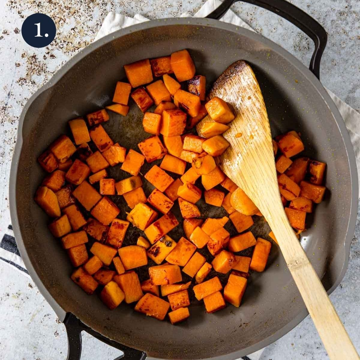 cubed sweet potatoes in a skillet