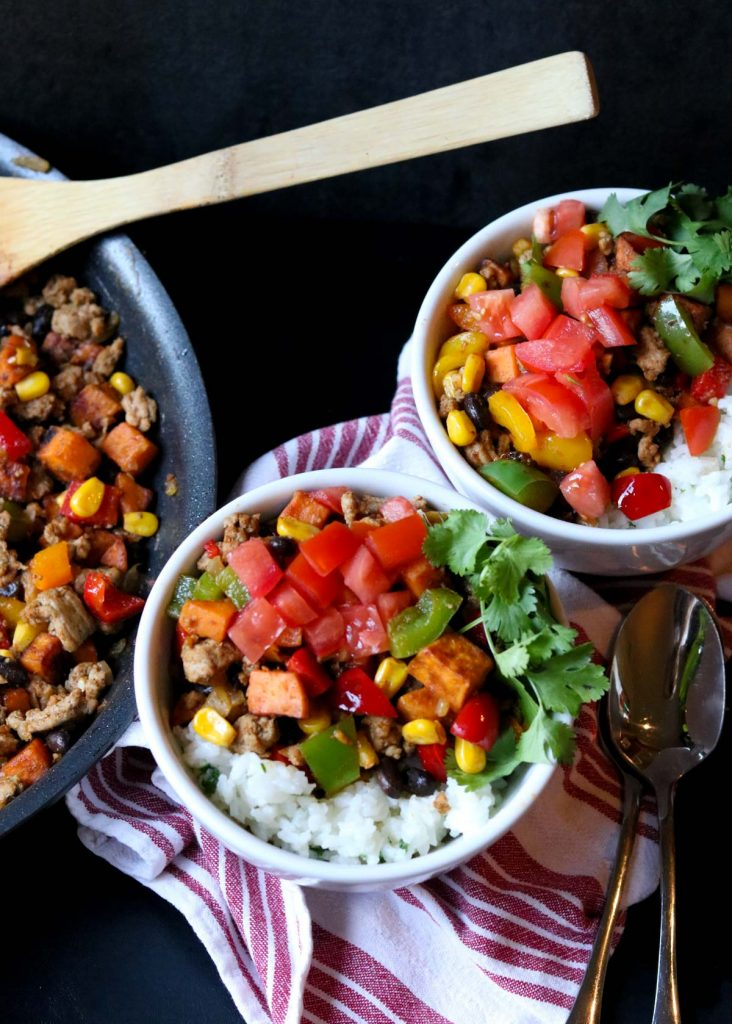 two bowls of Southwest Sweet Potato & Turkey over cilantro lime rice