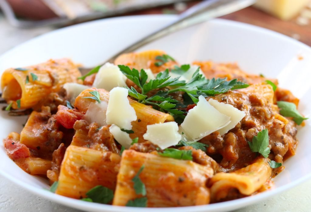 Instant Pot Rigatoni with tomato cream sauce in a bowl with parsley and parmesan