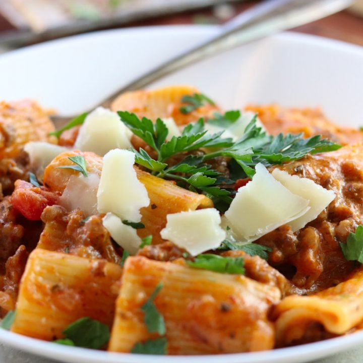 Sausage Rigatoni with tomato cream sauce in a bowl with parsley and parmesan