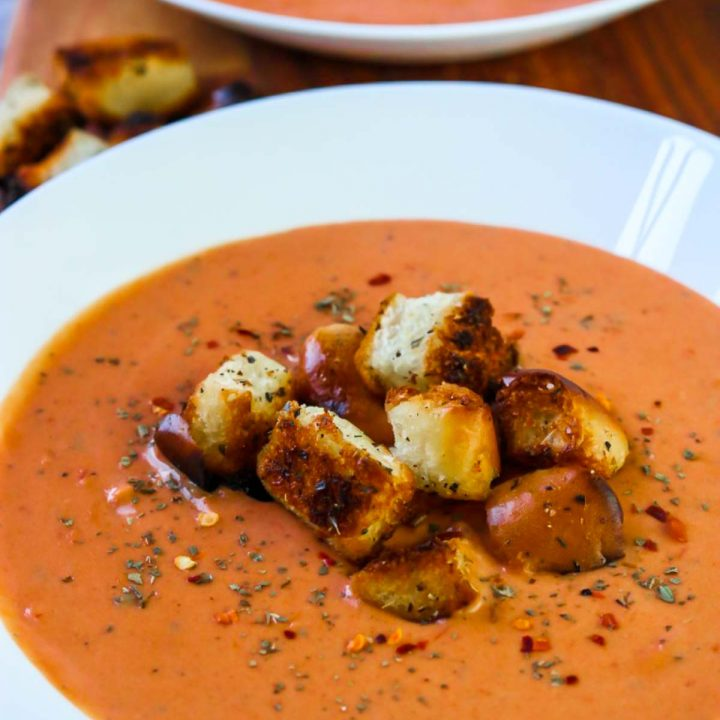 5 Minute Tomato Basil Soup with Garlic Croutons in a white bowl