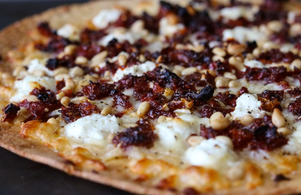 Goat Cheese Pizza with Sun Dried Tomatoes and Pine Nuts