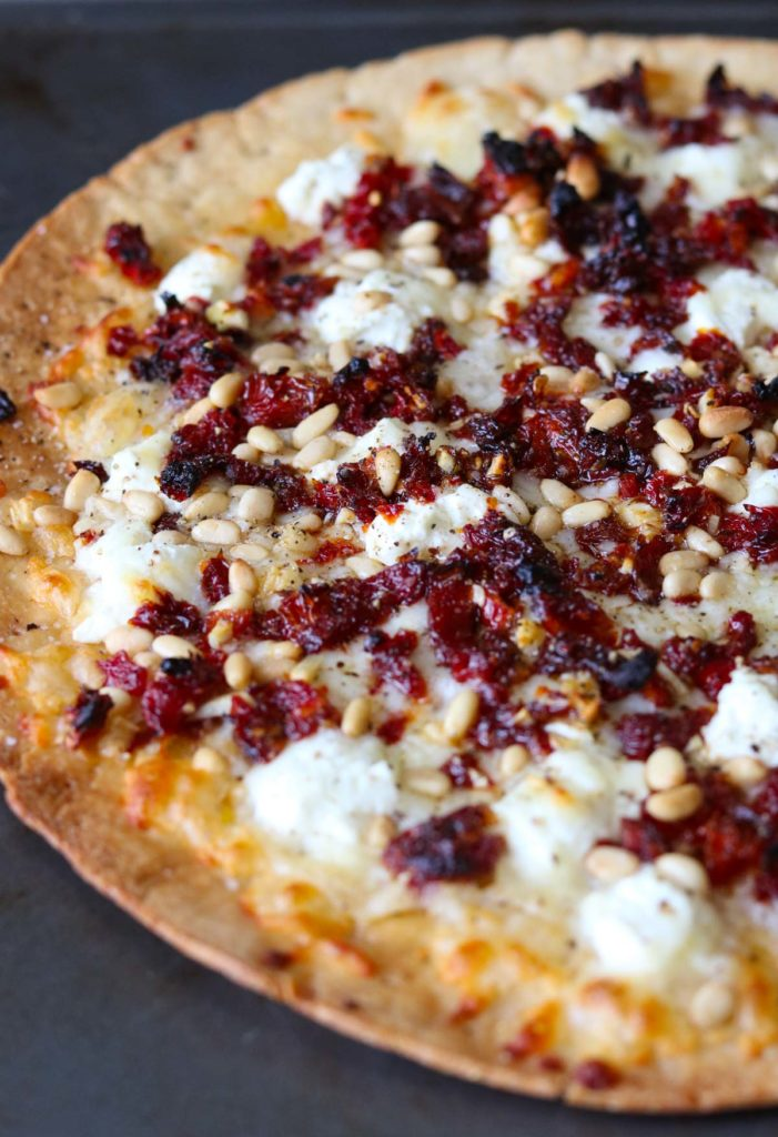 Goat Cheese Pizza with Sun Dried Tomatoes and Pine Nuts straight out of the oven momsdinner.net