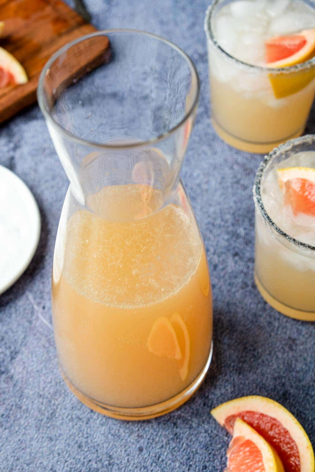 a pitcher filled with grapefruit margarita