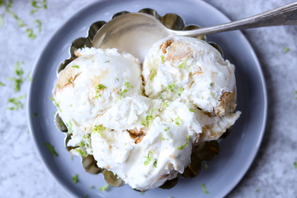 No Churn Key Lime Ice Cream in a silver dish with a spoon