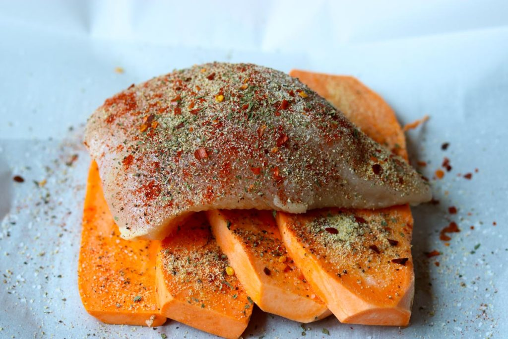 Chicken in Parchment with Sweet Potatoes sprinkled with seasonings