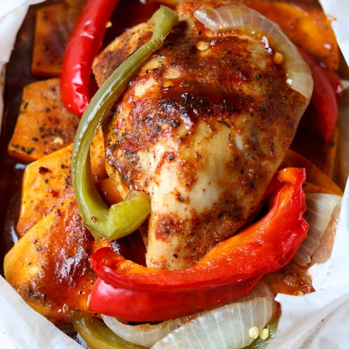sweet potatoes and peppers under chicken with bbq sauce