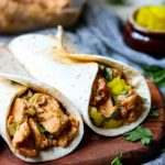 Creamy Chicken Tacos recipe. All the ingredients get mixed together and baked in the oven in 20 minutes. Put the filling in a soft taco shell and fill with your favorite toppings. Perfect FAST dinner, especially if you pick up a rotisserie chicken! via momsdinner.net #tacos #chicken #easydinner #mexican #dinnertonight