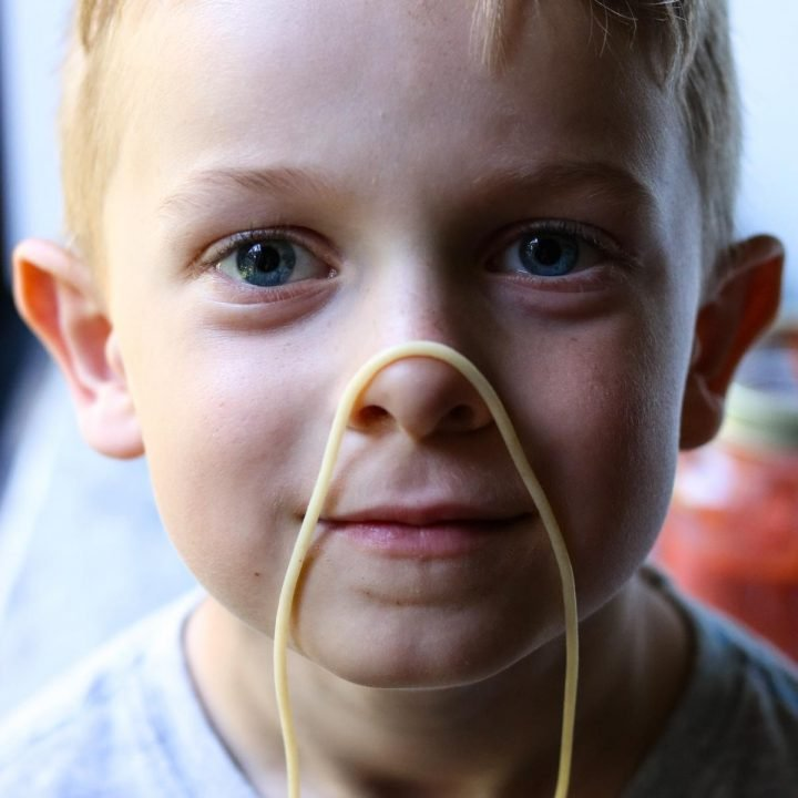 Kyle with spaghetti on his nose (1 of 1)