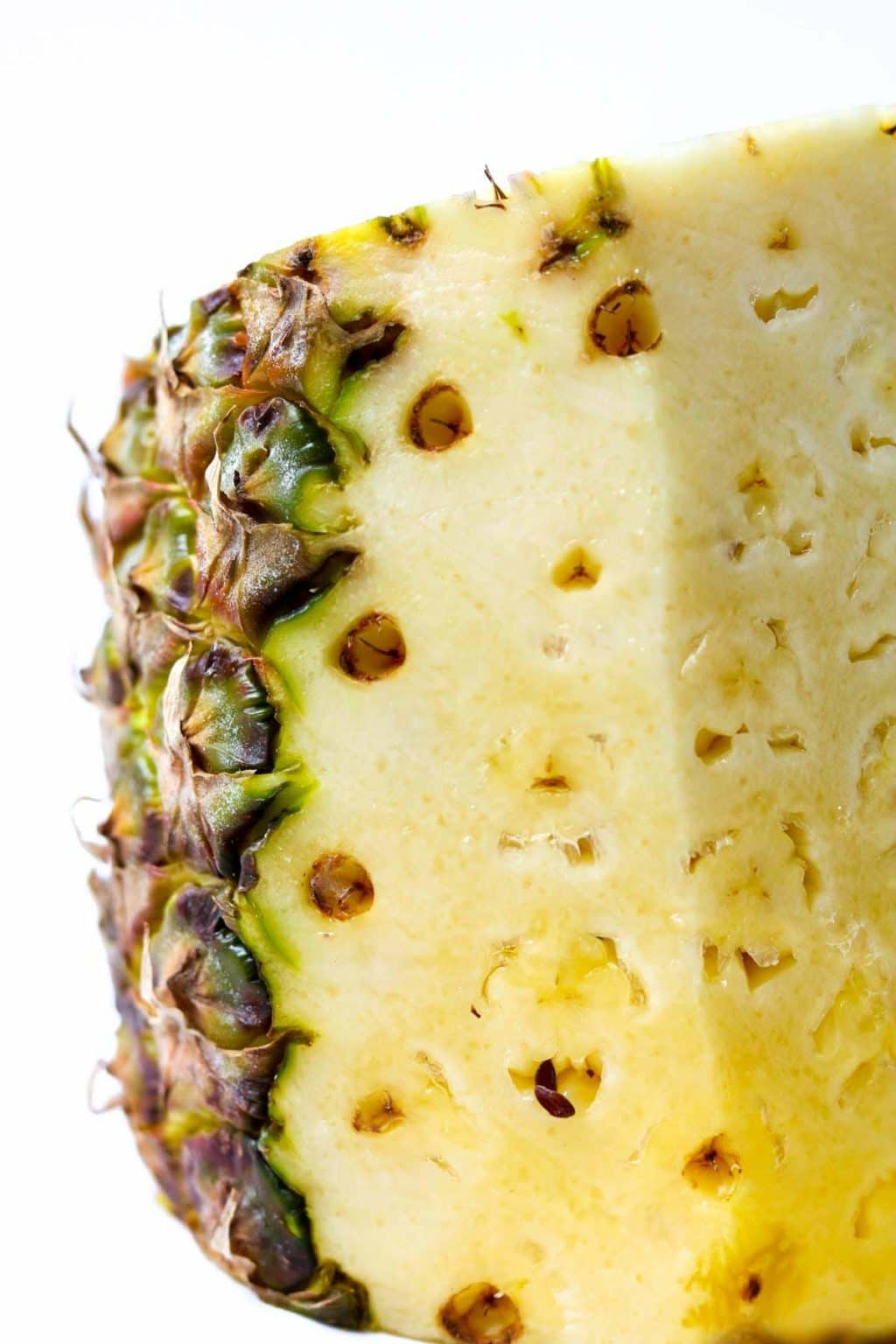 Showing the pine spots in a pineapple that should be removed