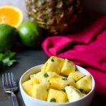Fresh Pineapple with Citrus Herb Glaze is a refreshing and cooling fruit side dish. It is excellent for breakfast, brunch, lunch or dinner. This fresh fruit side dish pairs well with spicy food, Mexican flavors, and barbecue. via momsdinner.net #pineapple #cilantro #sidedish #fruitsidedish #barbecuesidedish #mexicansidedish