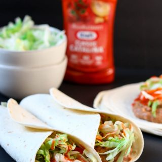 Catalina Bean Burritos are a 4 ingredient dinner that comes together in minutes. Perfect for busy nights! #easydinner #beanburrito #refriedbeans #burritos