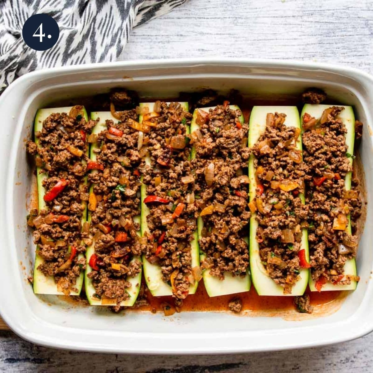 split zucchinis filled with ground beef