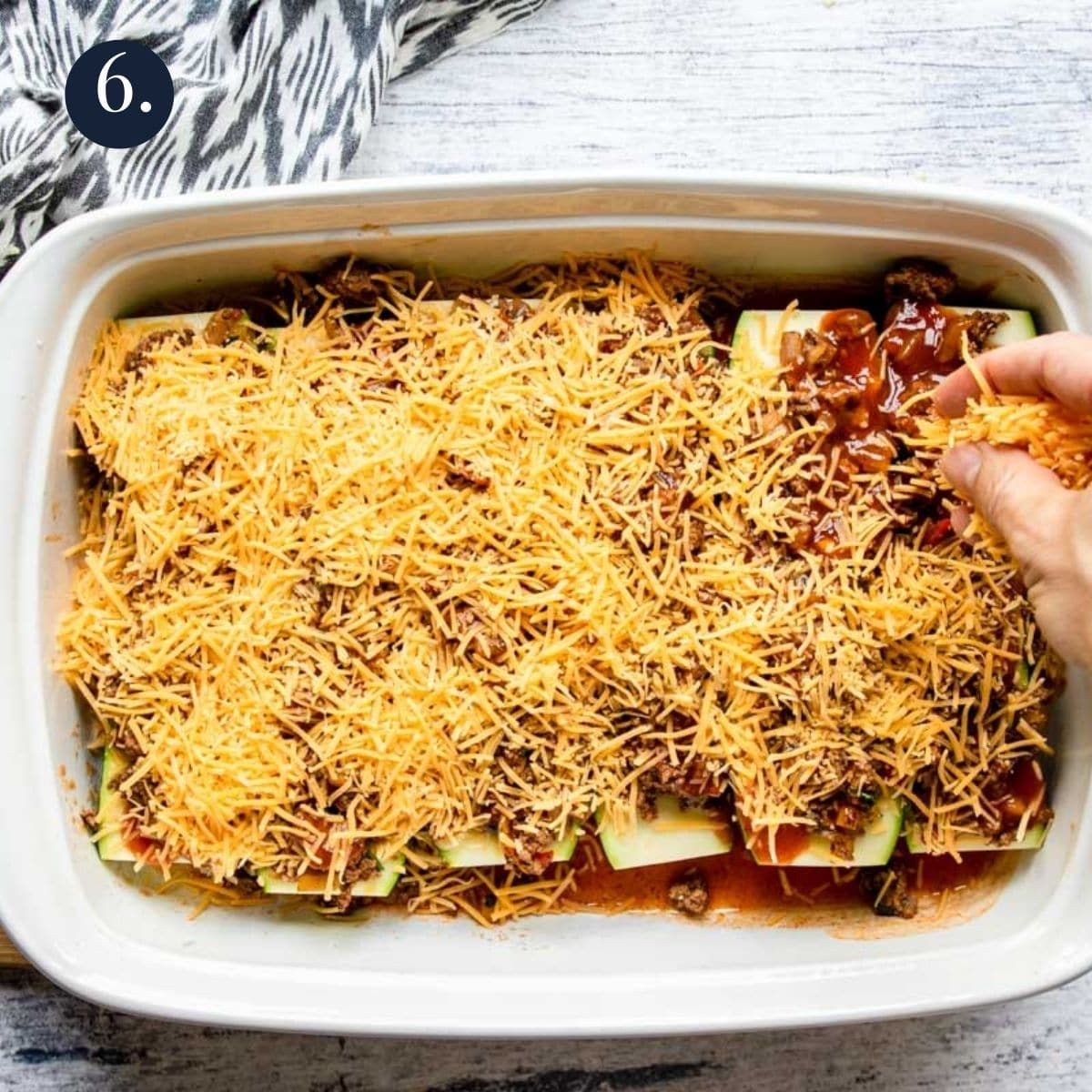 zucchini enchiladas topped with shredded cheese