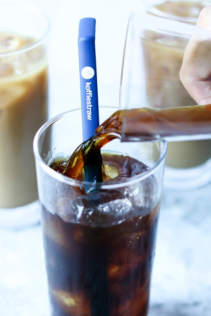 iced coffee being poured over ice