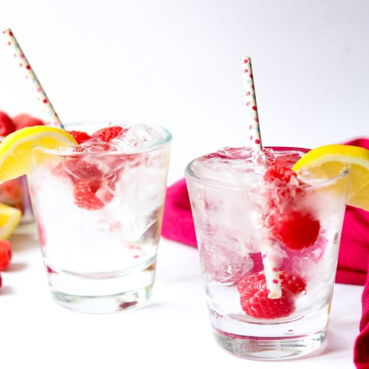 The raspberry vodka soda is a super refreshing and flavorful summer cocktail. It is not sugary or sweet but instead full of raspberry and citrus flavor with a few bubbles and lots of cold ice. #cocktail #vodka #drink #summer