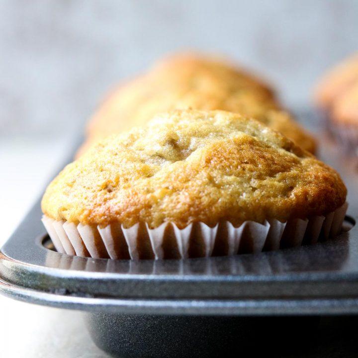 close up of a banana muffin in a muffin tin