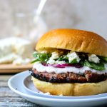 Bursting with Flavor.... This Grilled Greek Turkey Burger with Raspberry Mint Aioli is super easy to put together and is made with easy to find ingredients. The Raspberry Mint Aioli is the topper to this turkey burger and it is simply made with mayonnaise, store-bought raspberry vinaigrette, and fresh mint. #greek #turkeyburger #feta #aioli #dinner