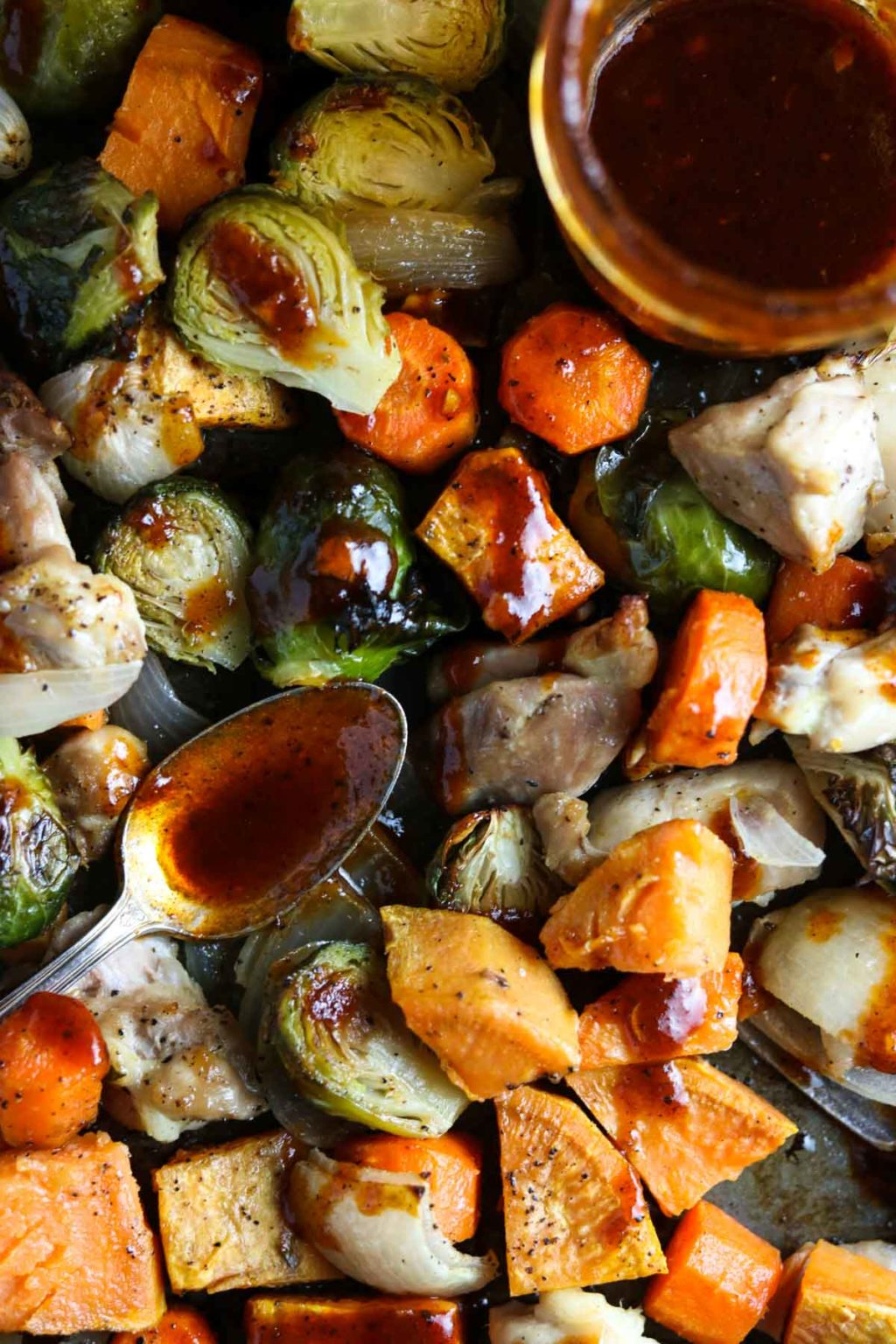brussel sprouts, chicken, carrots, sweet potatoes, and onions drizzles with bbq vinaigrette