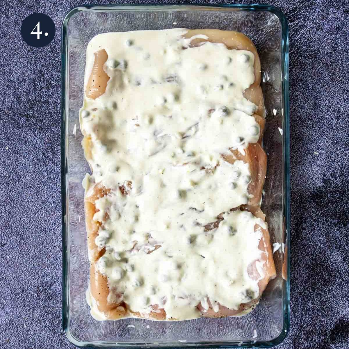 Ceasar Cream Sauce poured over top of raw chicken