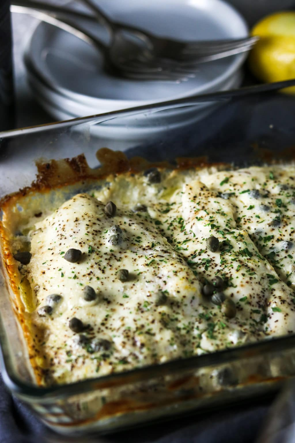 chicken breast, baked and covered in a cream sauce and capers