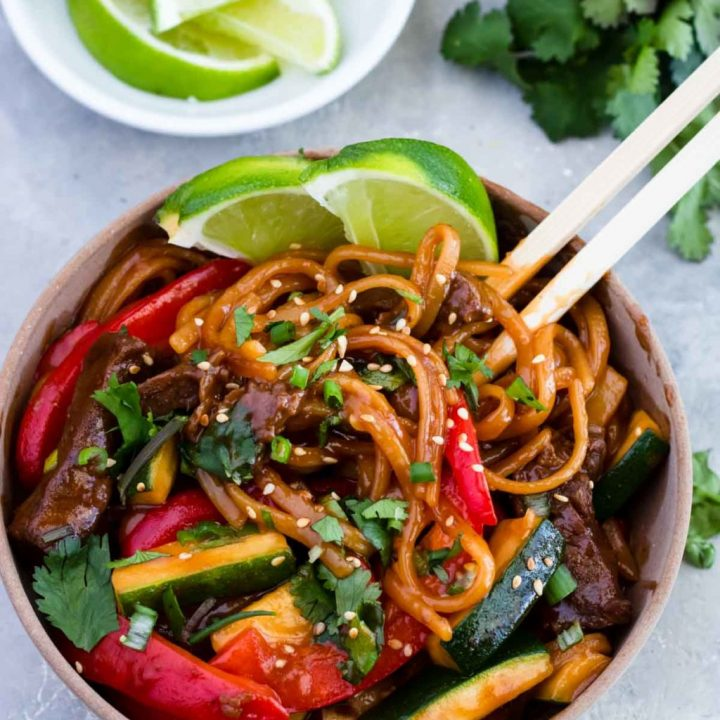 Instant Pot Teriyaki Beef Noodles in a bowl with chopsticks