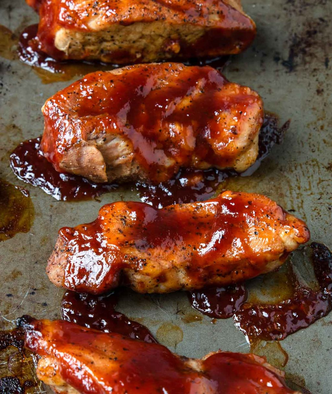 up close photo of boneless pork ribs coated with bbq sauce