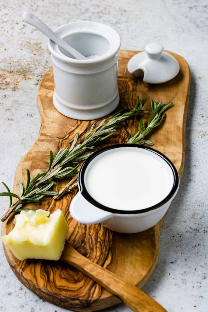 4 of the ingredients in cauliflower puree: Butter, half and half, salt, and rosemary