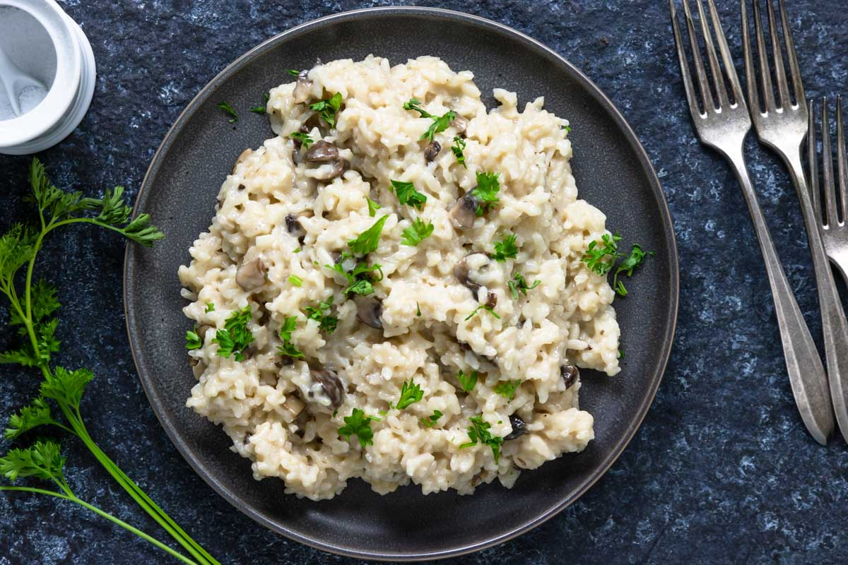 risotto with mushrooms on a plate with parsley
