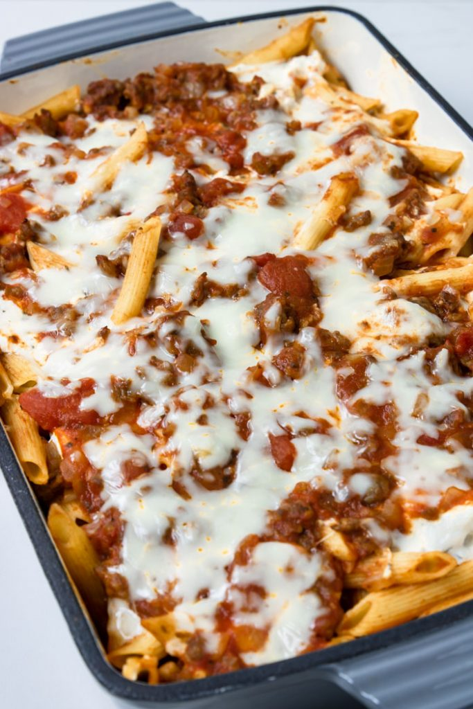 Baked Penne Pasta in a grey casserole pan