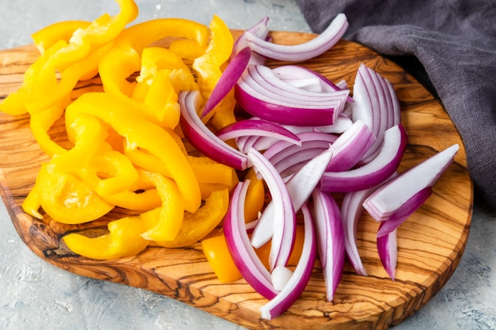 yellow peppers and red onions cut into strips