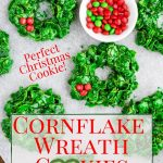Cornflake Wreaths on a baking sheet with red M&M's - pinterest text overlay