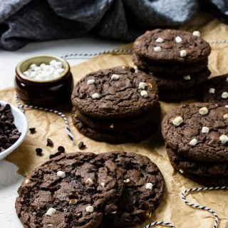 Hot cocoa cookies in stacks on brown parchment paper
