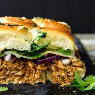 BBQ Chicken Slider Sandwiches on a black slate board