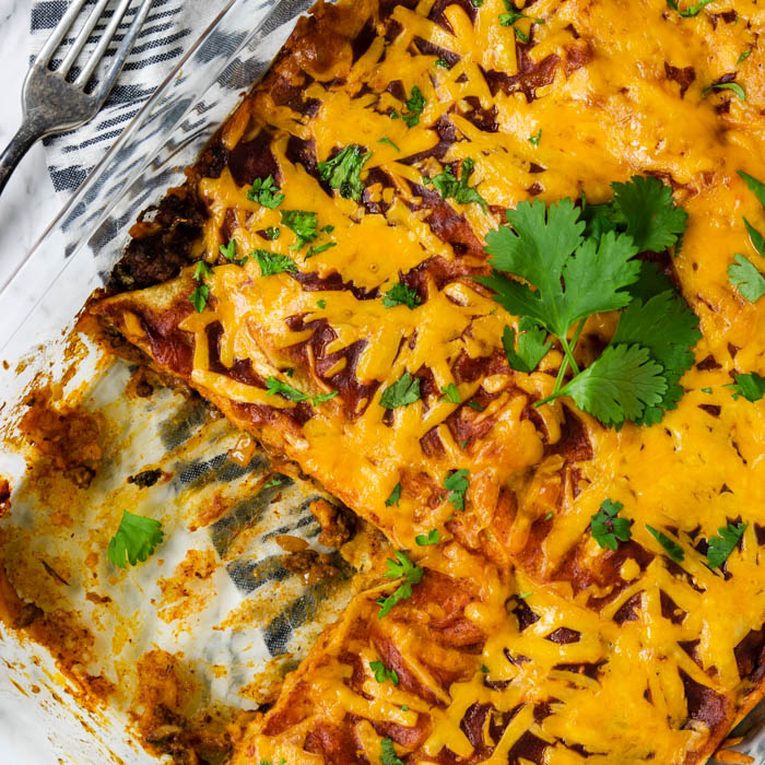 enchilada casserole with a slice taken out
