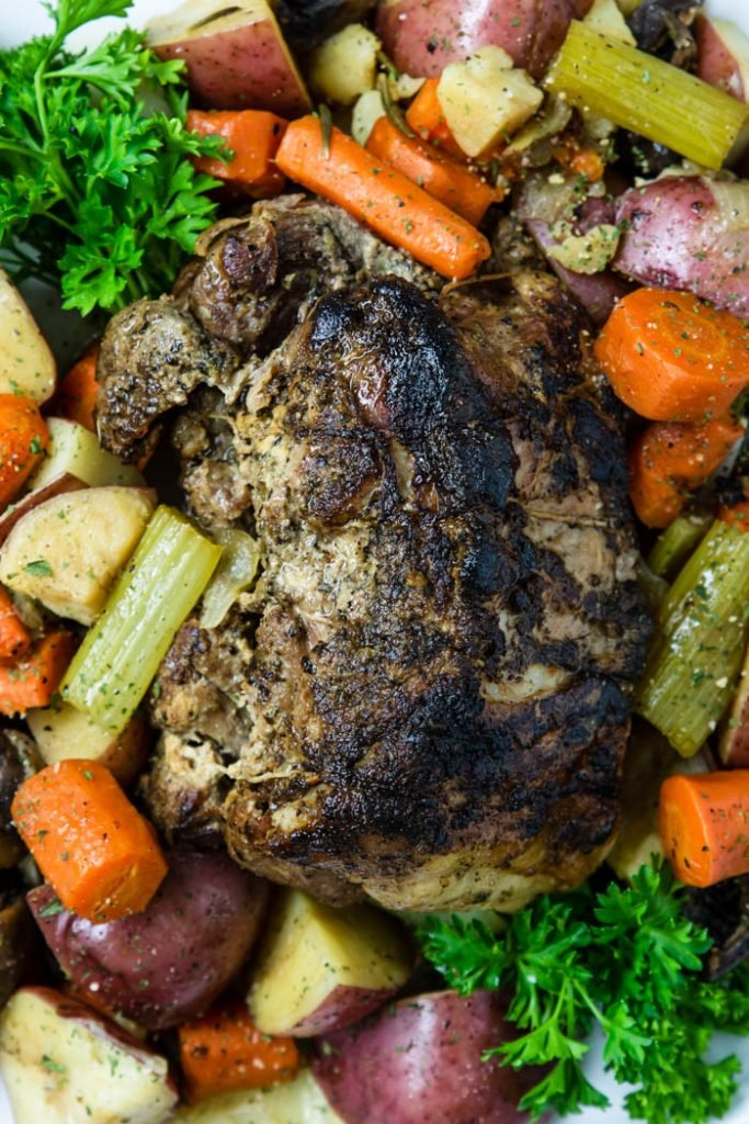 Instant Pot Pork roast surrounded by veggies on a platter