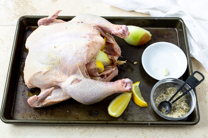 whole chicken stuffed with onions and lemons