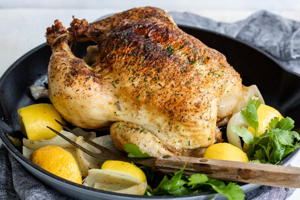 Whole Rotisserie Chicken with lemons and onions