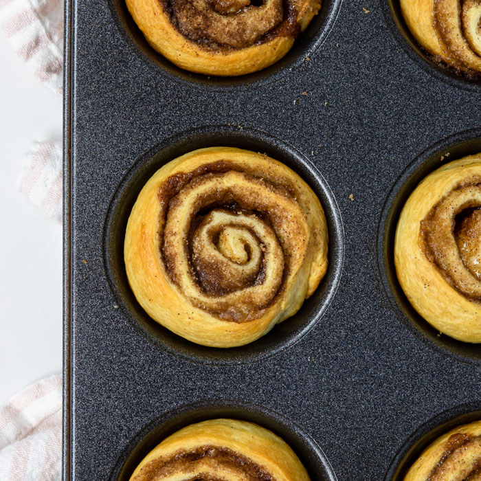 cooked cinnamon roll in a muffin tin