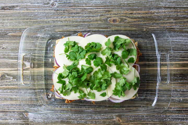 cilantro on top of the provolone cheese