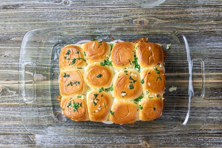 Baked BBQ Chicken Slider sandwiches in a casserole pan