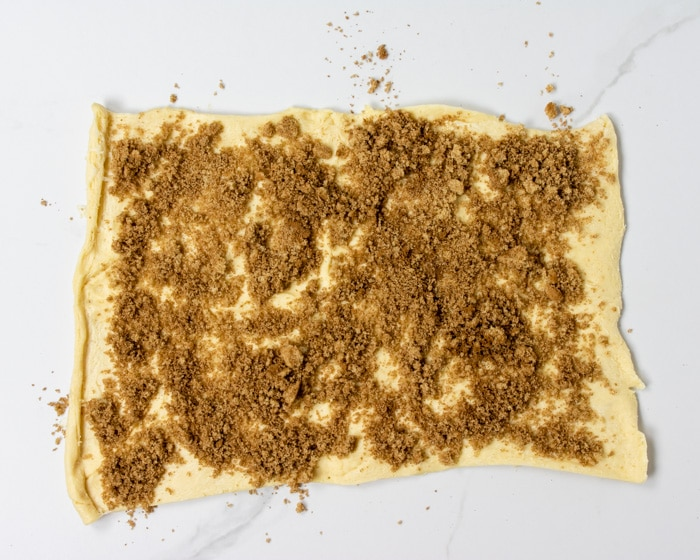 crescent dough topped with cinnamon sugar filling