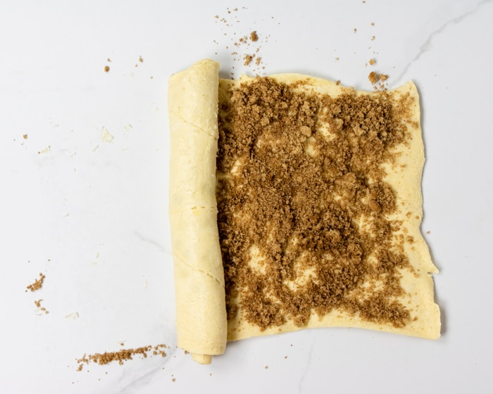 rolling the dough over the cinnamon sugar filling