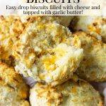 garlic cheddar biscuit opened to show the melted cheddar - pinterest text