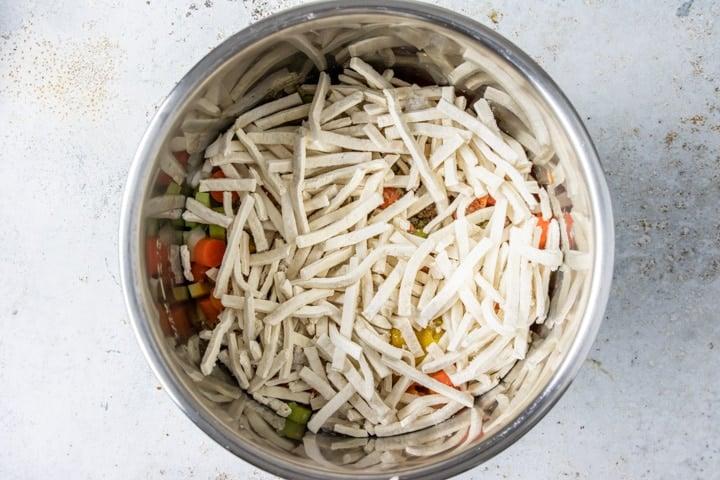 Step 3: pour in a 12 oz bag of frozen egg noodles