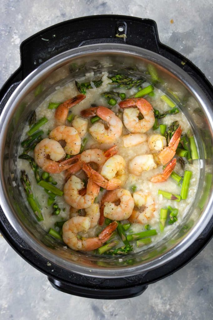marinated and sauteed shrimp on top of risotto and asparagus in the Instant Pot